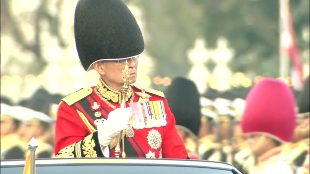 2 cuts middle distance shot of king bhumibol in car at royal thai armed forces military review/close up of king bhumibol in car at military review... - king of thailand stock videos and b-roll footage
