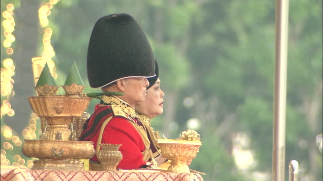 2 cuts pan left from soldiers lined up in ranks at royal thai armed forces military review and middle distance shot of king bhumibol seated on... - king of thailand stock videos and b-roll footage