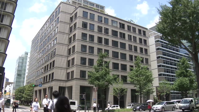 the appearance of the building which houses takeda pharmaceutical head office osaka city osaka japan / cristophe weber ceo of takeda pharmaceutical... - 登場点の映像素材/bロール