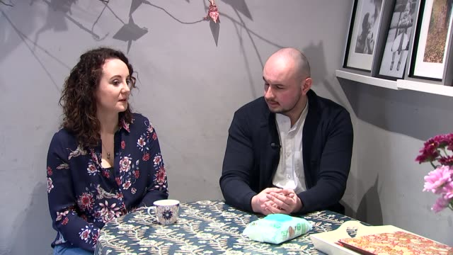 cuts to vital service for new parents and babies scrutinised; england: ext mark edwards along to knock on door / jane fisher answering door int jane... - pen and ink stock videos & royalty-free footage