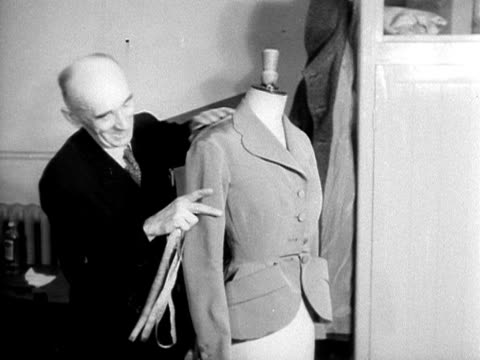 stockvideo's en b-roll-footage met a cutter alters a jacket on a dressmakers dummy at the lachasse fashion house 1953 - cut video transition