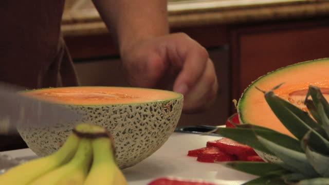 cutting a cantaloupe