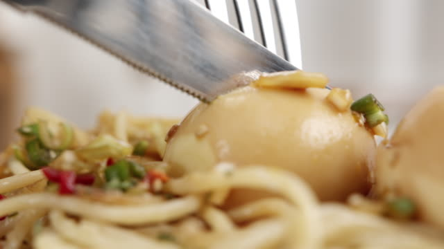 cutting a egg of 'gyeranjang' on a pasta - lunch stock videos & royalty-free footage