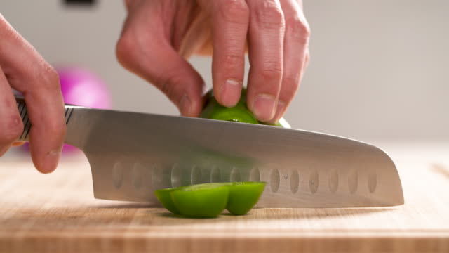 cutting a green bell pepper / south korea - pepper vegetable stock videos & royalty-free footage