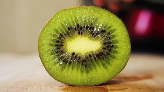 cutting a kiwi fruit in half with a knife - kiwi fruit stock videos and b-roll footage