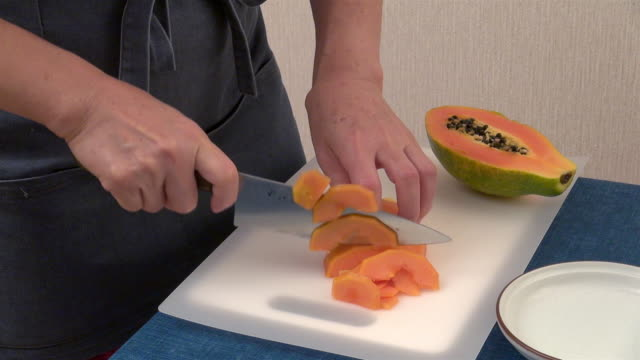 cutting a papaya - papaya stock videos & royalty-free footage