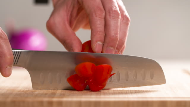 cutting a red bell pepper / south korea - bell pepper stock videos & royalty-free footage