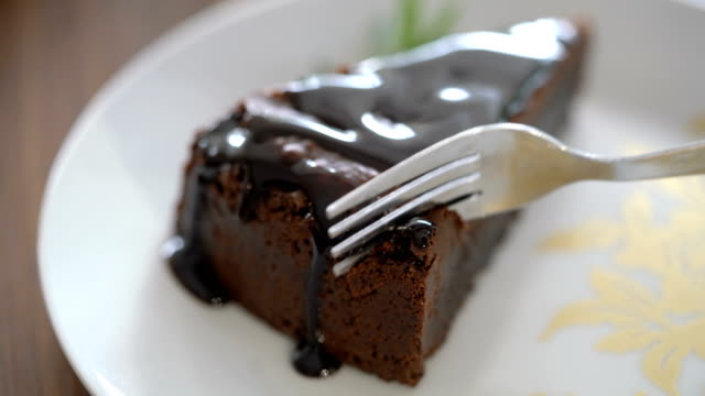 4k cutting a slice of chocolate cake with folk - dessert stock videos & royalty-free footage