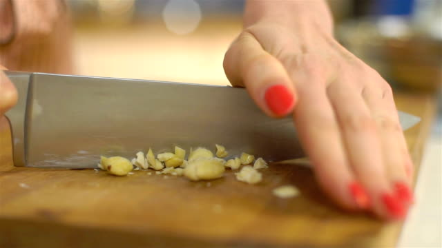 cutting almond, slo mo - almond stock videos and b-roll footage