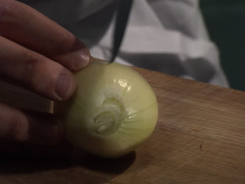 cutting an onion in half - unknown gender stock videos & royalty-free footage