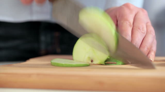 Cutting apple on slices