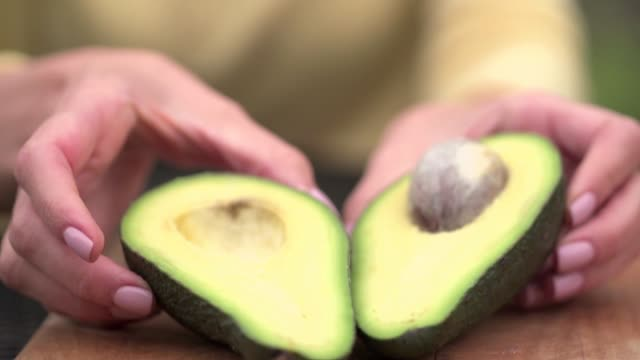 cutting avocado in half - vegetable stock videos & royalty-free footage