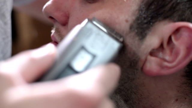cutting beard. close up - electric razor stock videos and b-roll footage