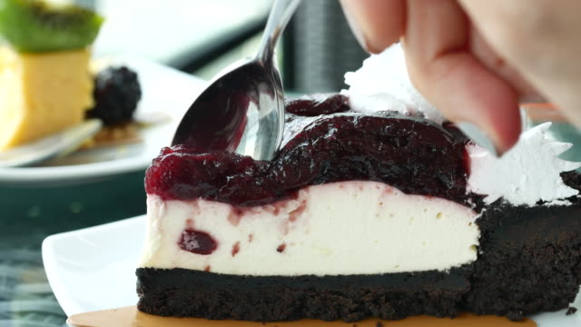 Cutting blueberry Cheesecake