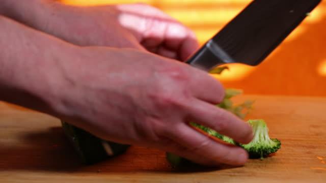 Cutting broccoli florets.