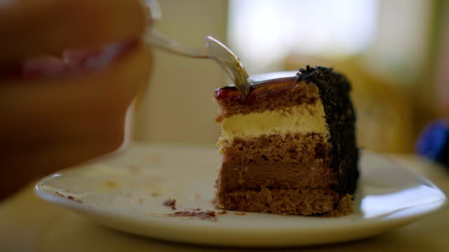 cutting caramel cake - teaspoon stock videos and b-roll footage