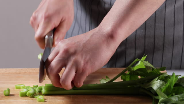 vídeos y material grabado en eventos de stock de cutting celery with a knife on the chopping board - apio