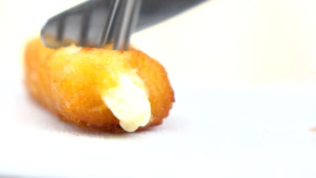 cutting cheese stick - mozzarella stock videos & royalty-free footage
