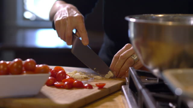 cutting cherry tomatoes and garlic - anorexia nervosa stock videos & royalty-free footage