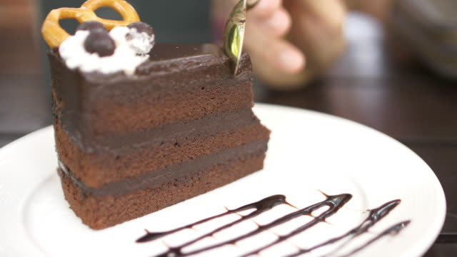 cutting chocolate cake, 4k - sequential series stock videos & royalty-free footage