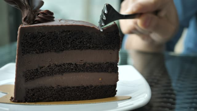 cutting chocolate cake in the cafe - french culture stock videos & royalty-free footage