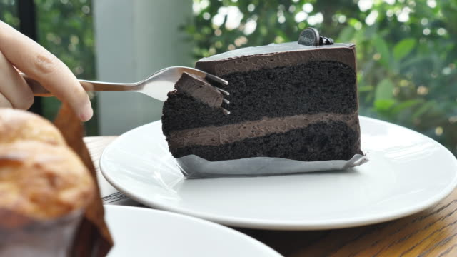 Cutting chocolate cake, Slow motion