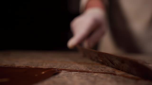 cutting chocolate icing on baking sheet - baking sheet stock videos & royalty-free footage