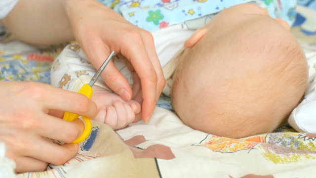 Cutting fingernails of baby