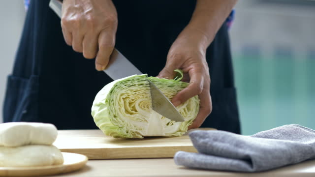 cutting fresh cabbage - coleslaw stock videos & royalty-free footage