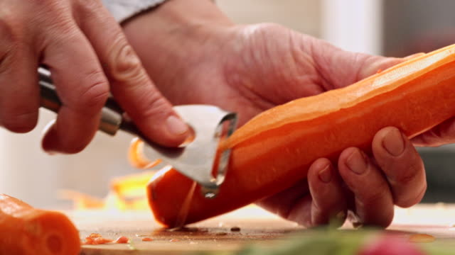 cutting fresh carrots for preparing salad - carrot stock videos and b-roll footage