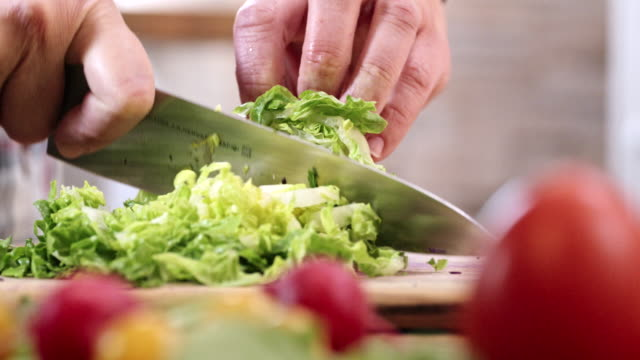 cutting fresh green salad for preparing salad - chopped stock videos and b-roll footage