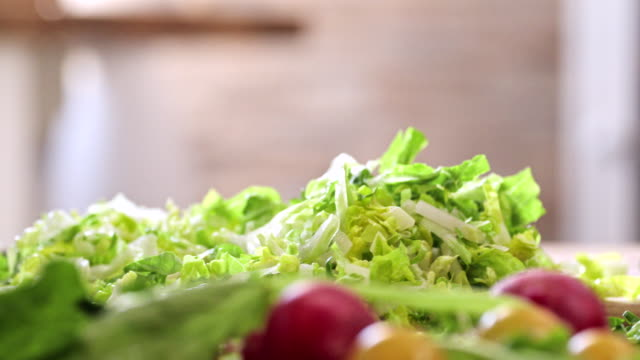 Cutting Fresh Green Salad for Preparing Salad