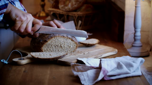 cutting fresh homemade brown bread - loaf stock videos & royalty-free footage