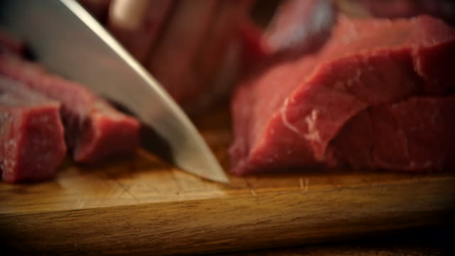 cutting fresh meat to ground it in a mincer - meat stock videos & royalty-free footage