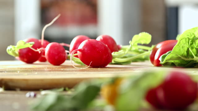cutting fresh radishes for preparing salad - salad bowl stock videos & royalty-free footage