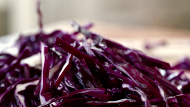 cutting fresh red cabbage for preparing salad - coleslaw stock videos & royalty-free footage