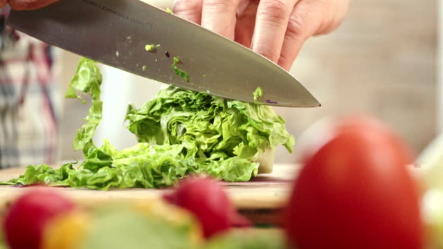 Cutting Fresh Vegetables for Preparing Salad