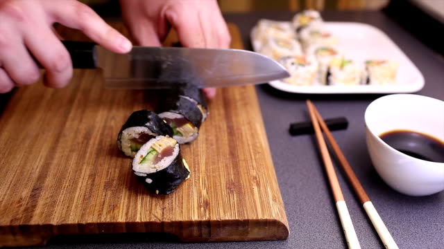 cutting futomaki sushi roll - sushi stock videos and b-roll footage