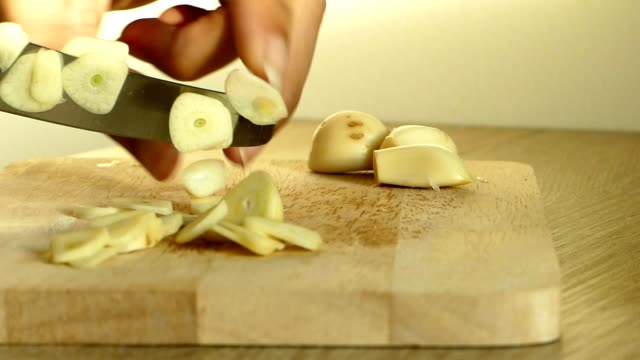 cutting garlic - garlic stock videos & royalty-free footage