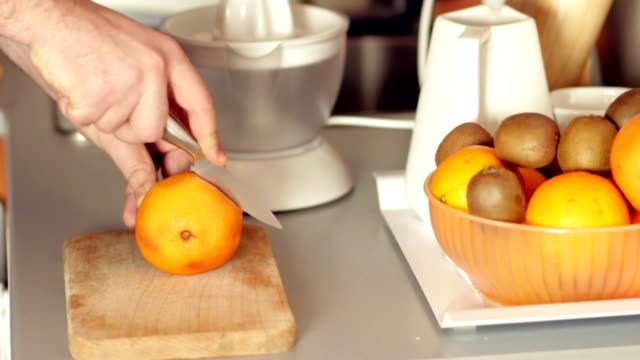 cutting grapefruit - cutting stock videos & royalty-free footage