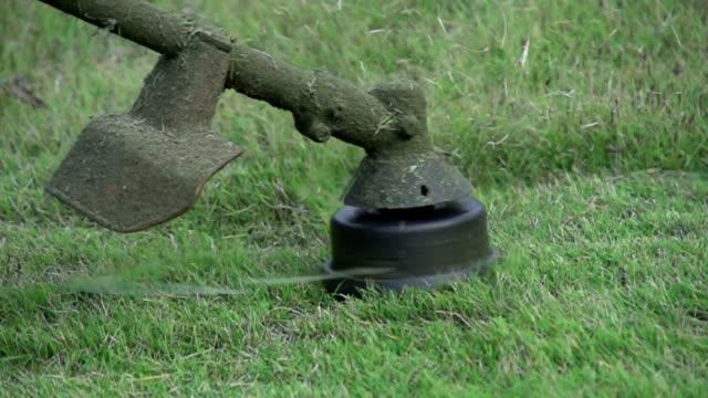 cutting grass  slowmotion - lawn stock videos & royalty-free footage