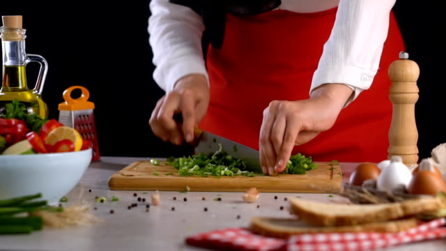 cutting green pepper on chopping board slow motion - chopped food stock videos and b-roll footage