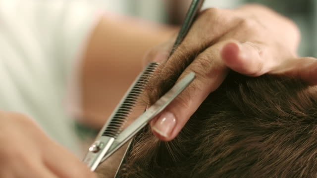 cutting hair - hairdresser stock videos & royalty-free footage
