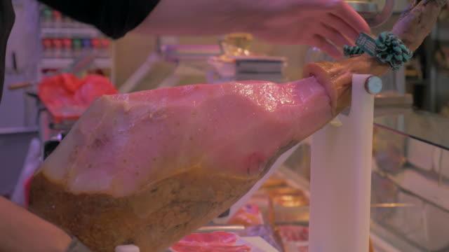 cutting jamon serrano - skåp med glasdörrar bildbanksvideor och videomaterial från bakom kulisserna
