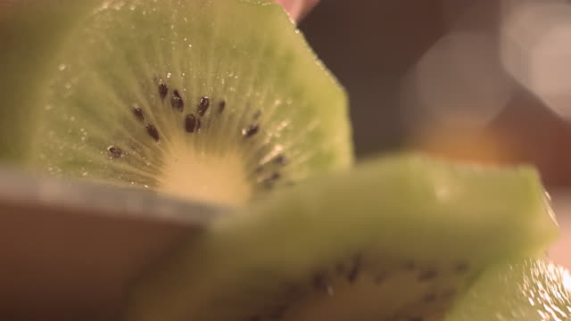 cutting kiwi fruit with knife. - vitamin c stock videos and b-roll footage