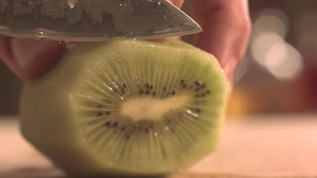 cutting kiwi fruit with knife. - ascorbic acid stock videos & royalty-free footage
