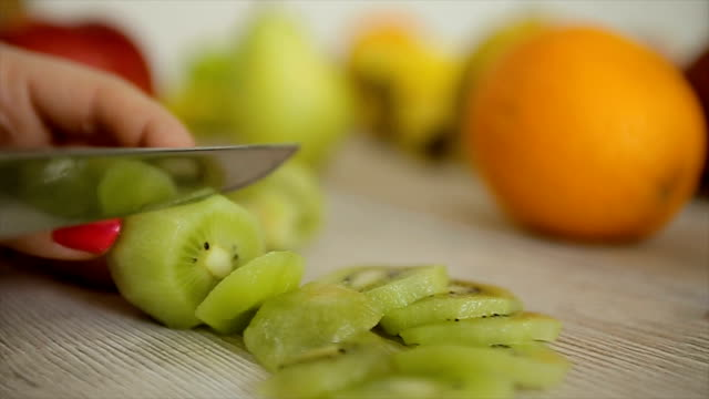 cutting kiwi fruit,close up - detox stock videos & royalty-free footage