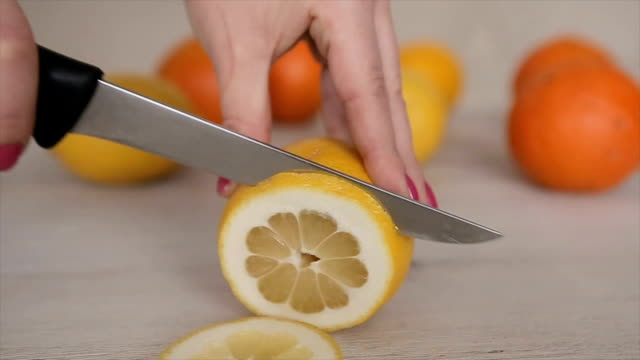 cutting lemon,close up - lemon stock videos & royalty-free footage