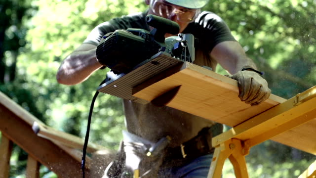 cutting lumber - one mature man only stock videos & royalty-free footage