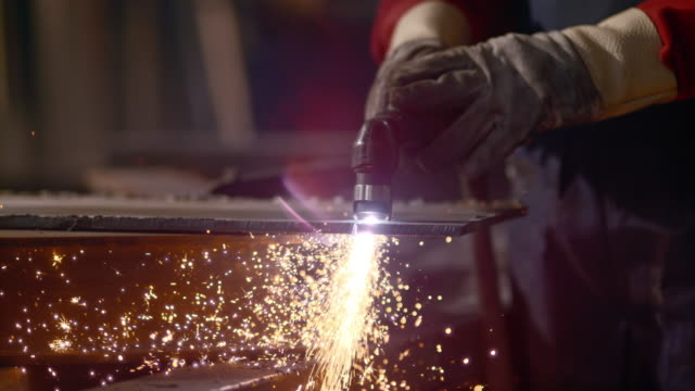 slo mo cutting metal causing sparks - girder stock videos & royalty-free footage